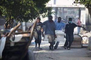 David Levene in Haiti: A coffin is brought to the national cemetery in Port-au-Prince