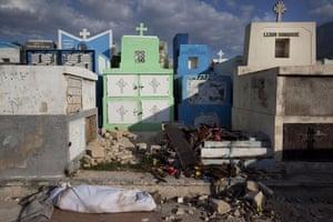 David Levene in Haiti: A body lies in the cemetery in Port-Au-Prince, awaiting burial