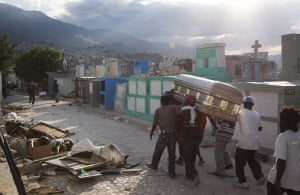 David Levene in Haiti: A coffin containing a victim is brought to the cemetery in Port-Au-Prince