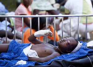 David Levene in Haiti: A young boy who was has no family, age or name lies injured at the hospital
