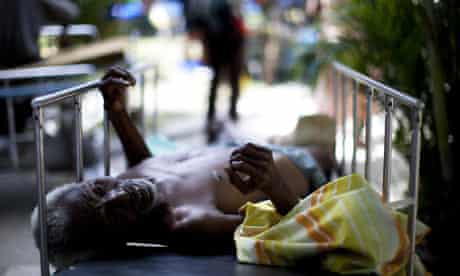 A man is treated in the yard of the general hospital in Port-au-Prince, Haiti.