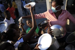 Lawless Haiti: People try to get food at a food distribution centre in Port-au-Prince