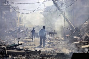 Lawless Haiti: People walk down a street with several fires burning in Port-au-Prince