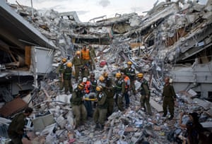 Lawless Haiti: Israeli rescuers retrieve an injured person from the rubble