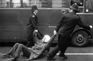Jayaben Desai: A male striker is dragged away by two policemen