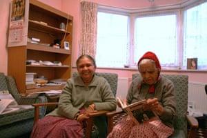 Jayaben Desai: Two elderly women sit in armchairs smiling