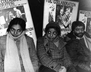 Jayaben Desai: Three strikers sit with placards behind them