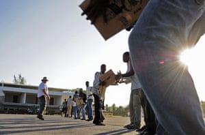 Haiti Aid: Haitian citizens unload supplies