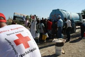 Haiti Aid: Spanish Red Cross workers distributing water