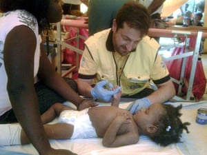 Haiti Aid: SURVIVORS AT A HOSPITAL IN PORT AU PRINCE