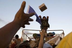 Haiti Aid: A Jordanian U.N. peacekeeper distributes food