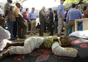 Haiti Aid: Bill Clinton (centre) gives an interview