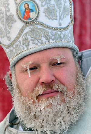 Orthodox Epiphany : An Orthodox priest with icy beard and eyebrows