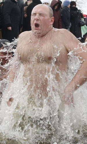 Orthodox Epiphany : Ukrainians reacts after a dip in an icy pond
