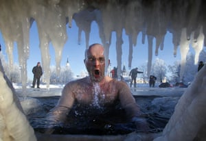 Epiphany: A Russian Orthodox believer swims in an ice hole