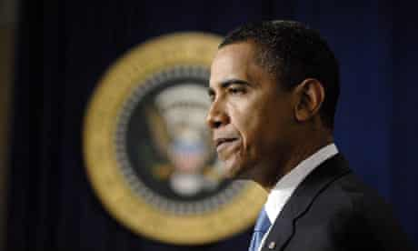 Barack Obama signs his first executive order