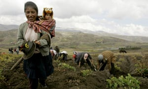 A farmer walks with her son in Peru