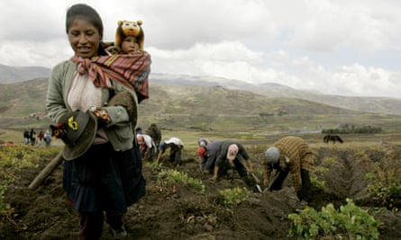A farmer walks with her son in Peru