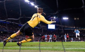 City v United: Tevez sends Van der Sar the wrong way to score from the penalty spot