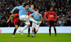 City v United: Tevez smashes the ball goalwards from the penalty spot
