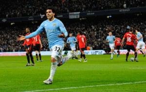 City v United: Tevez celebrates scoring from the penalty spot