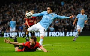 City v United: Tevez fouls Evans before getting a shot in on the United goal