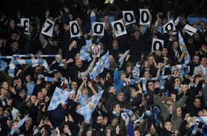 City v United: City fans taunt United fans about the Blues' wealth and the Reds' debt