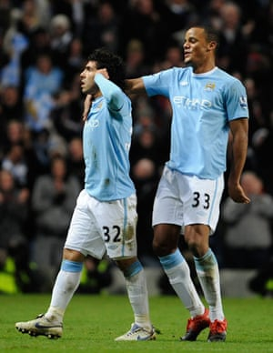 City v United: Tevez celebrates his 2nd goal in front of the dug-outs