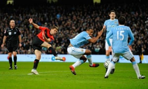 City v United: Michael Owen has his shot cleared off the line
