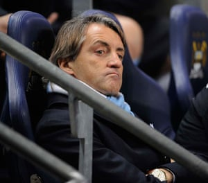 City v United: Roberto Mancini doesn't seem too impressed with his first Manchester derby