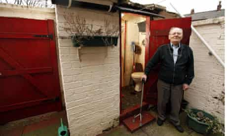 Fred Cawood outside his privy.