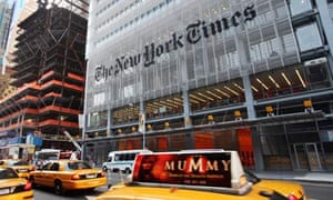 Yellow taxis in front of the New York Times building