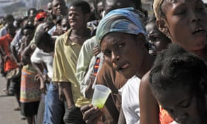 People queue for food in Port-au-Prince