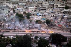 Aerial views of Haiti: Ruined buildings and fires burning in Port-au-Prince