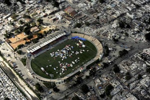 Aerial views of Haiti: A tent city set up in a sports stadium in Port-au-Prince