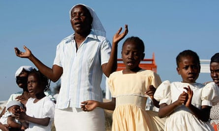 Worshippers during an outdoor Sunday service at a makeshift camp in Port-au-Prince