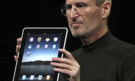 Apple CEO Steve Jobs holds the iPad