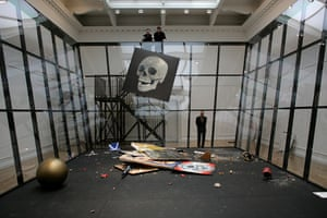 Michael Landy's art bin: A painting by Damien Hirst is dropped into the art bin, as Landy watches