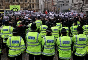 Anti-Blair protests: Police monitor demonstrators outside the Queen Elizabeth II Centre