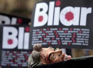 Anti-Blair protests: A protester's Tony Blair face mask outside the Queen Elizabeth II Centre