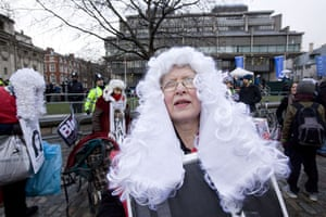 Anti-Blair protests: Demonstrators wearing judges' wigs outside the inquiry