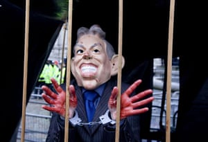 Anti-Blair protests: A protester wearing a mask depicting a caricature of Tony Blair