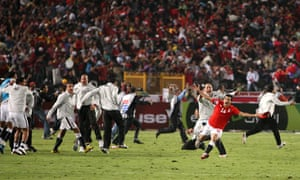 Egypt's team and fans celebrate after beating Algeria