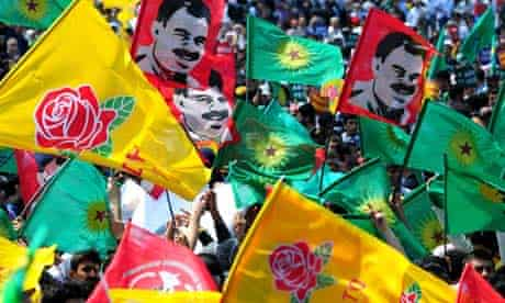 Kurds wave flags for the PKK and the Democratic Society Party (DTP) at a rally