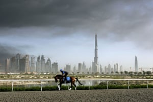 Burj Dubai: A horse practices at the Godolphin horse club in front of the Burj Dubai