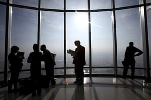 Burj Dubai: Members of the media look out from one of the observation decks