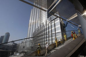 Burj Dubai: Workers put the final touches to the building ahead of the official opening