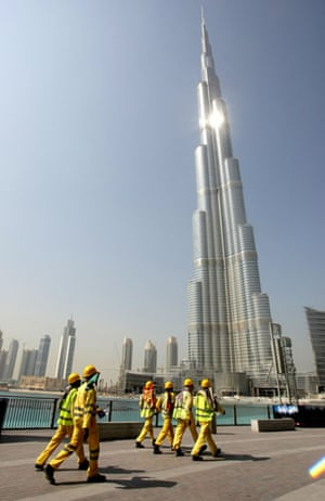 Burj Dubai: Construction workers walk past the Burj Dubai