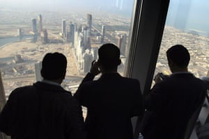 Burj Dubai: Members of the media look at the view of Dubai city from the 124th floor