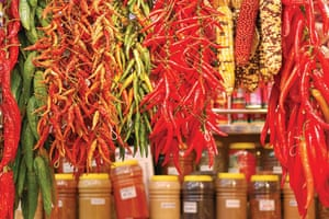 Visual History of Cooking: Various hanging chilli peppers and jars of Moorish spices
